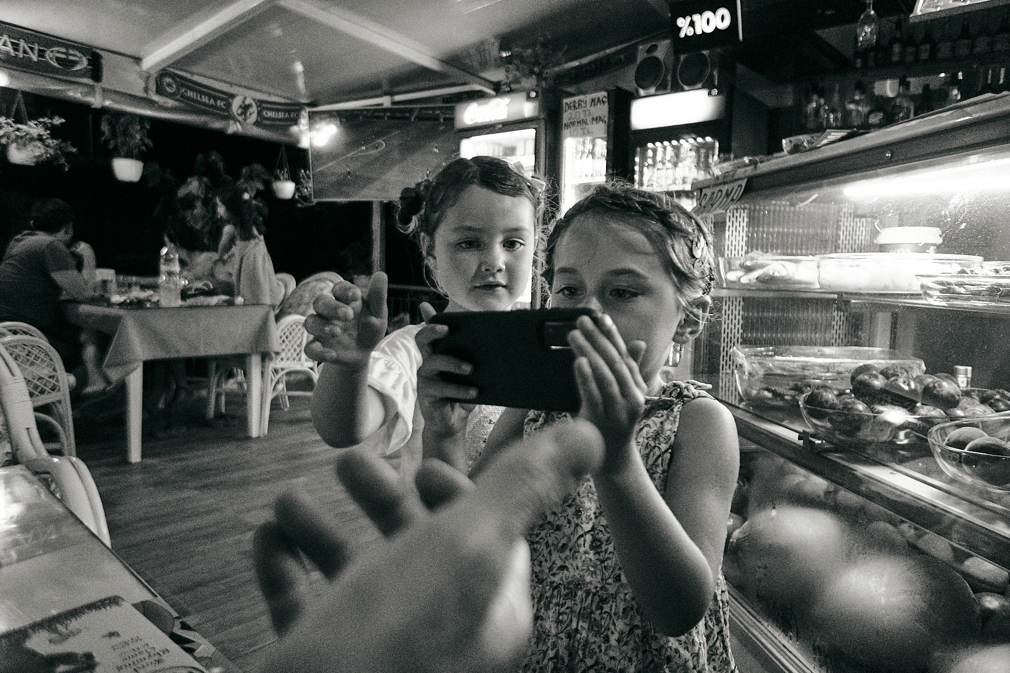 children try to take photo of parents