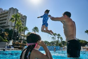 family playing in the pool at Fantasia Hotel