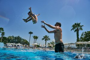 girl gets thrown in air by dad in the pool