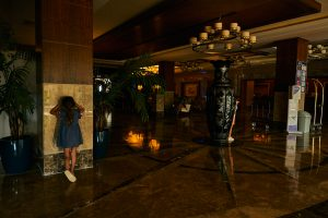 children playing hide and seek in empty hotel during covid19
