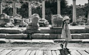 girl explores ruins at Ephesus in Turkey