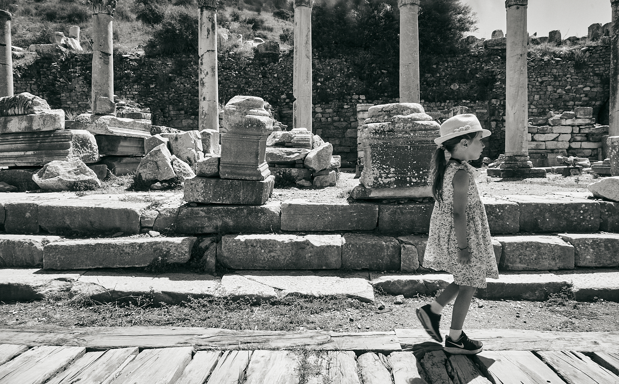 girl explores ruins at Ephesus in Turkey