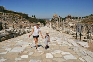 mum and daughter pose on quiet street in Ephesus