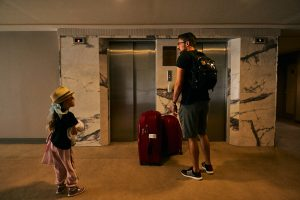 family wait for lift to leave holiday at Fantasia Hotel