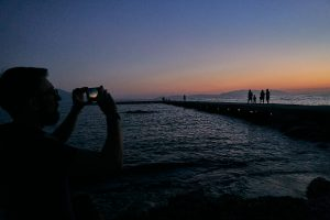 taking a photograph of the sunset in Kusadasi