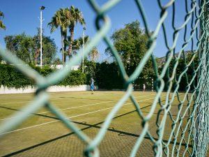 family play on empty sport court during coronavirus