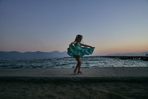girl spins in dress during sunset