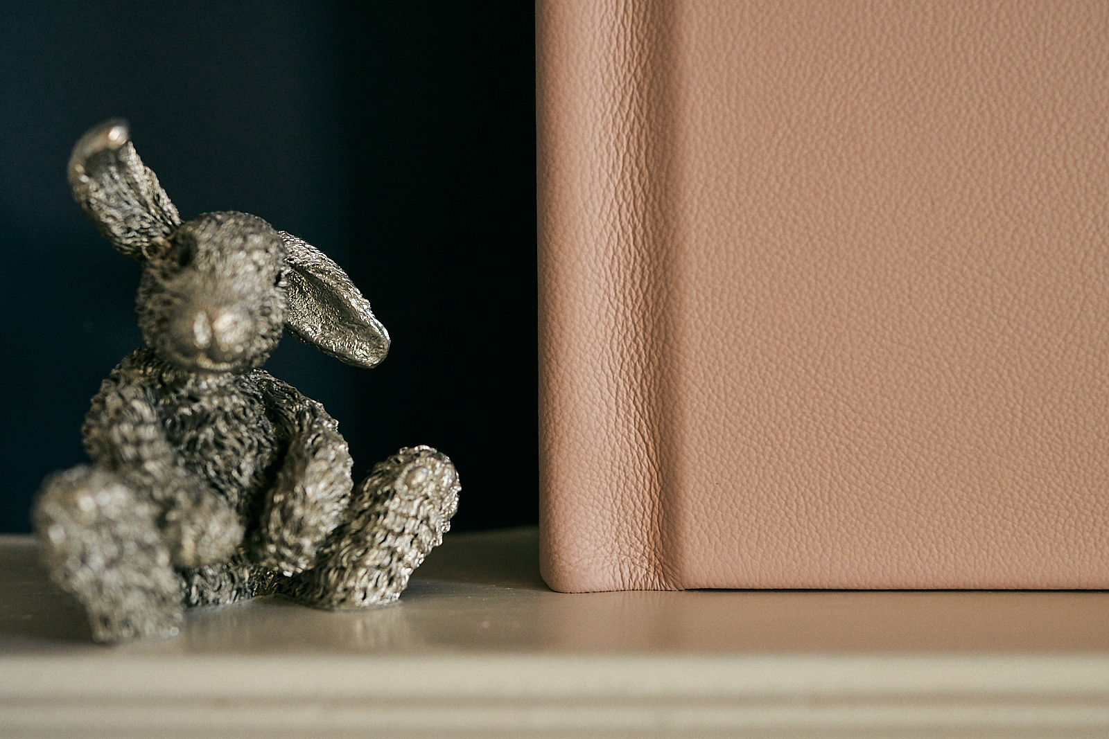 silver bunny next to pink leather family album