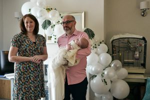 parents laugh during humanist naming ceremony on zoom