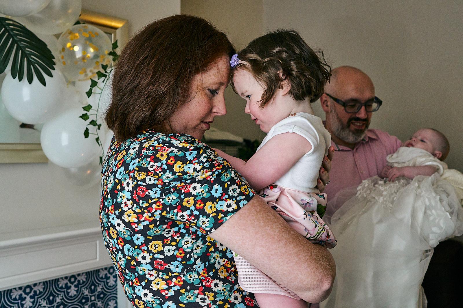 mum and daughter hug during visrtual naming ceremony