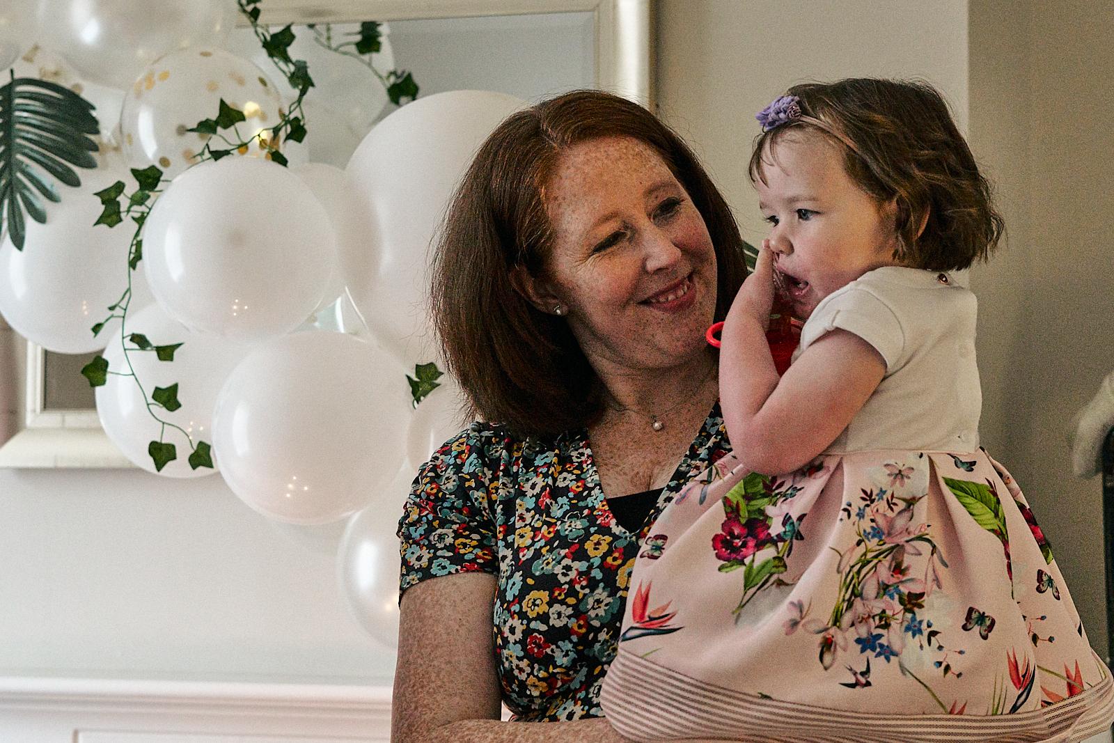 mum smiles at daughter during lockdown naming day