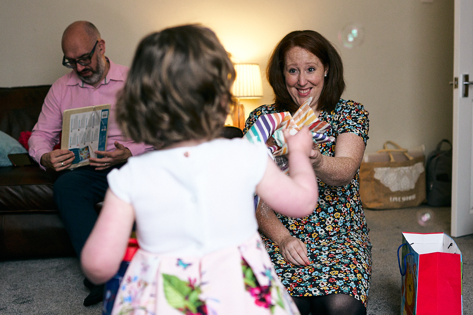 photo of happy mum giving out christening gifts