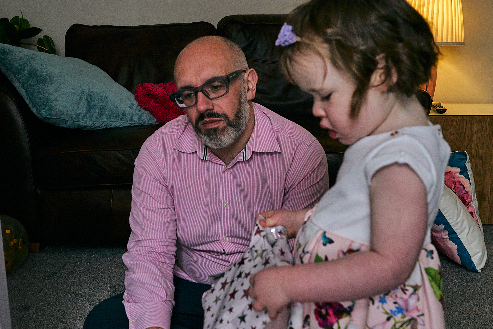 documentary photo of dad looks tired and fed up after naming day