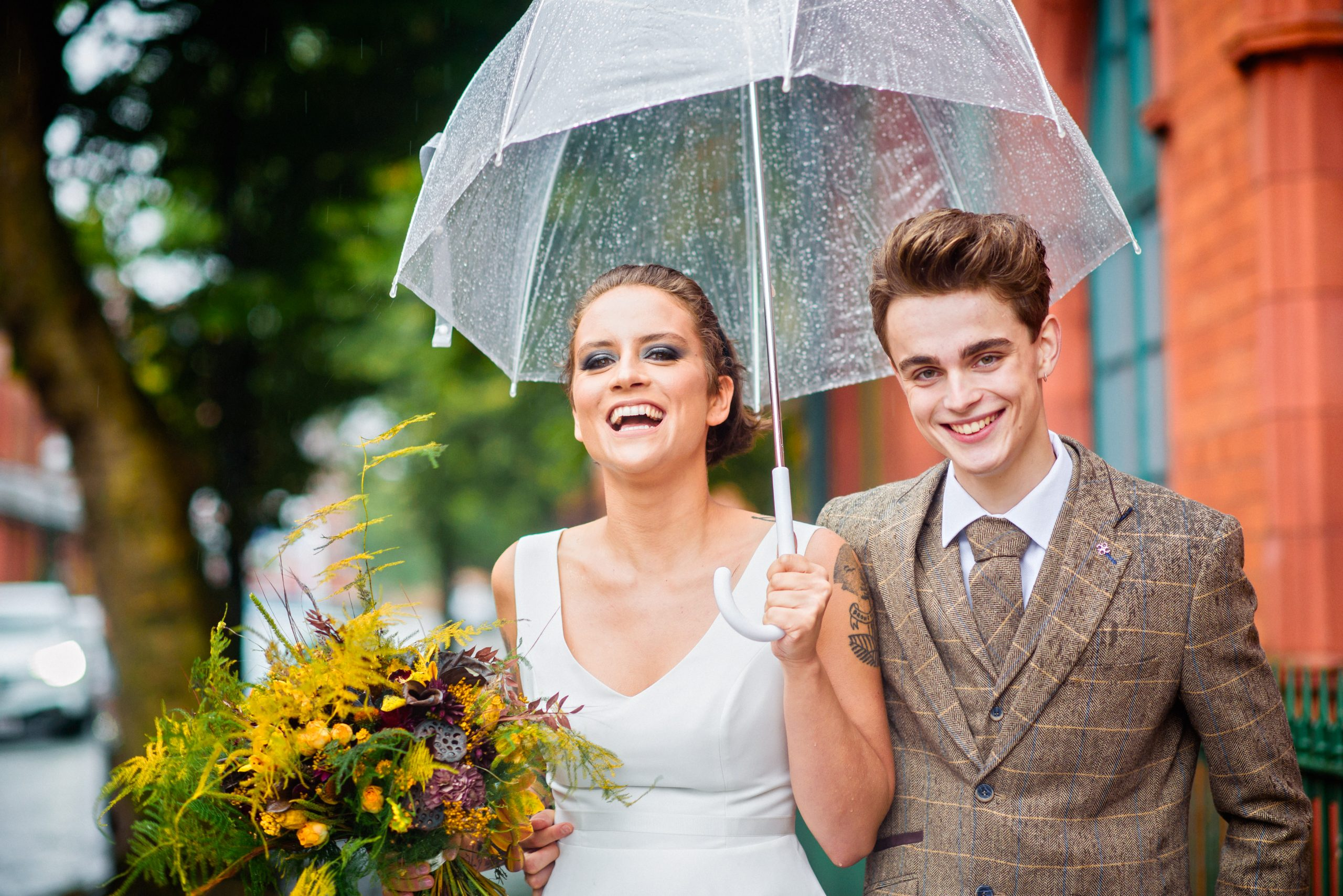 couple laugh in the manchester rain outside salford lads club