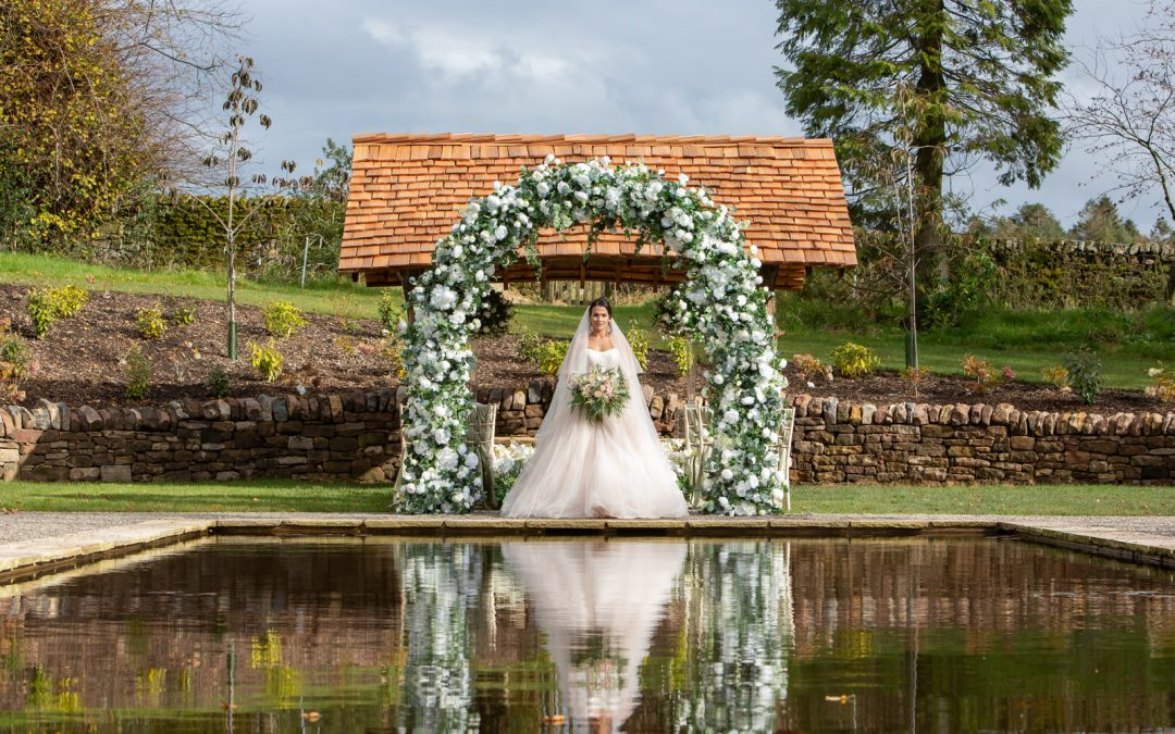 Beautiful ceremony at lily pond Browsholme Hall and Barn