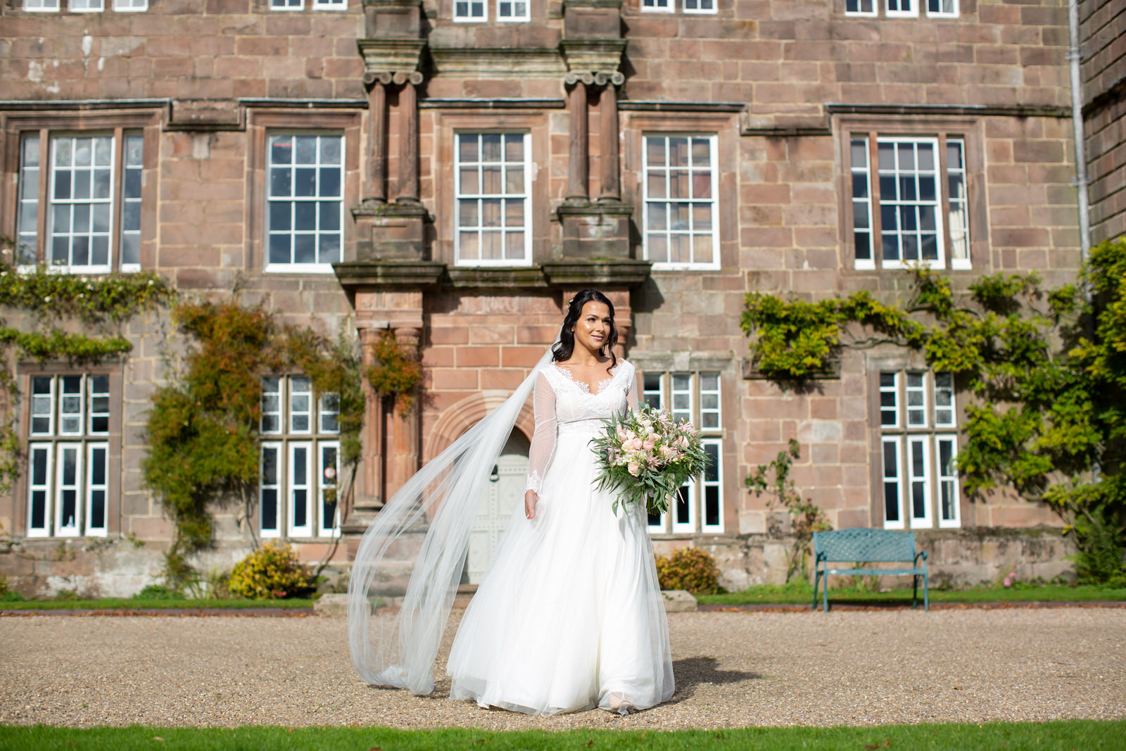 wind blows brides veil outside Browsholme hall Lancashire