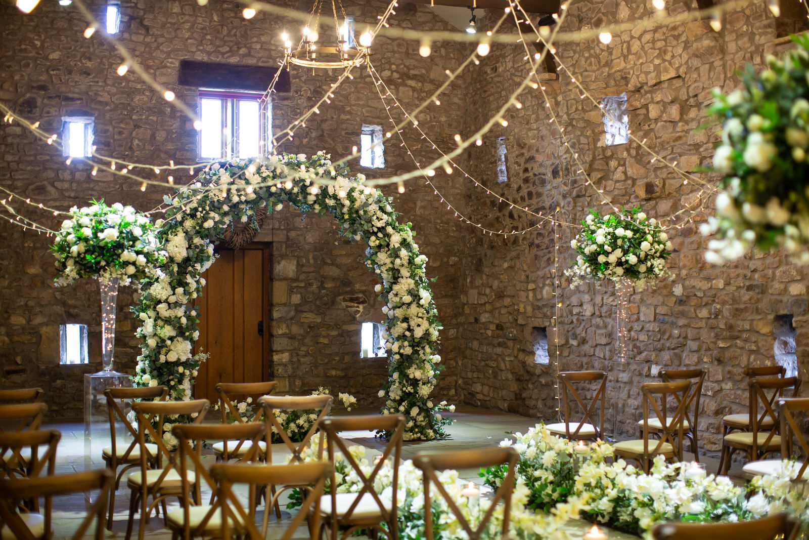 moongate white roses inside tithe barn lancashire