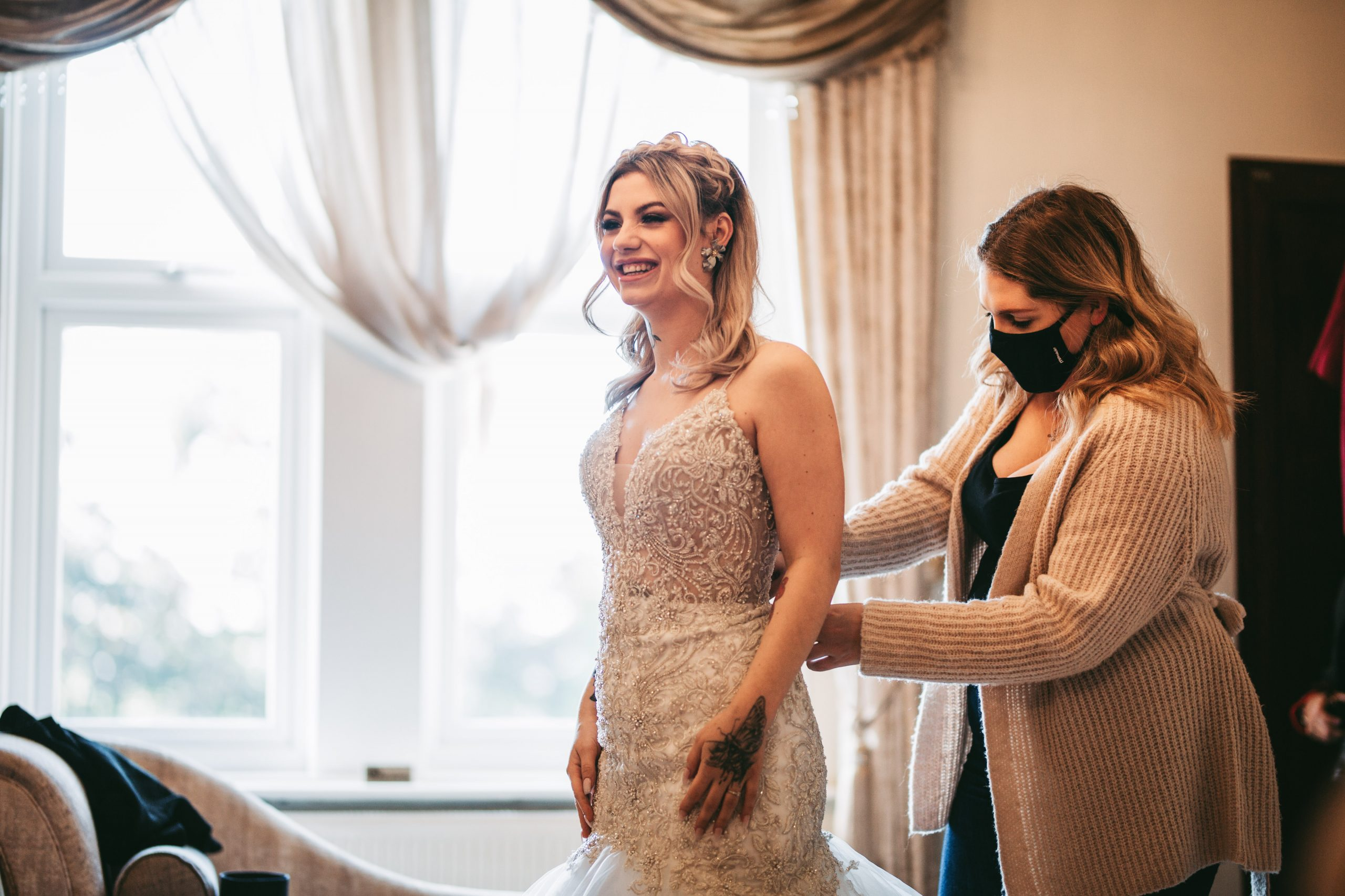 bride laughs as love story bridal gets her ready