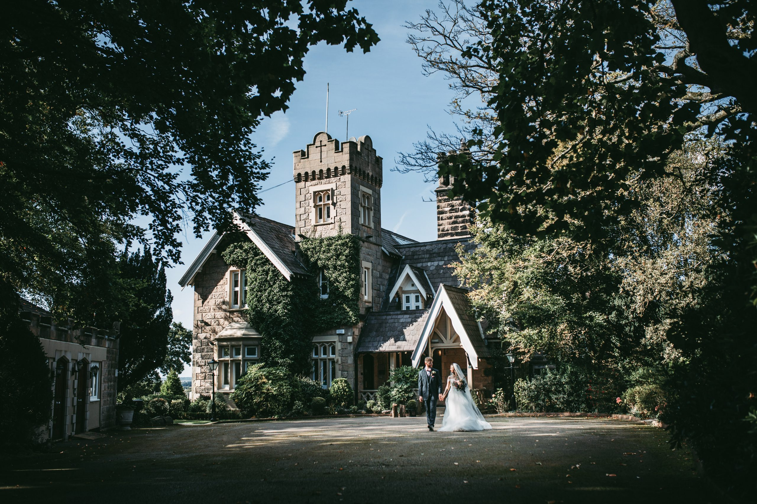 photo of front of west tower Ormskirk with bride and groom