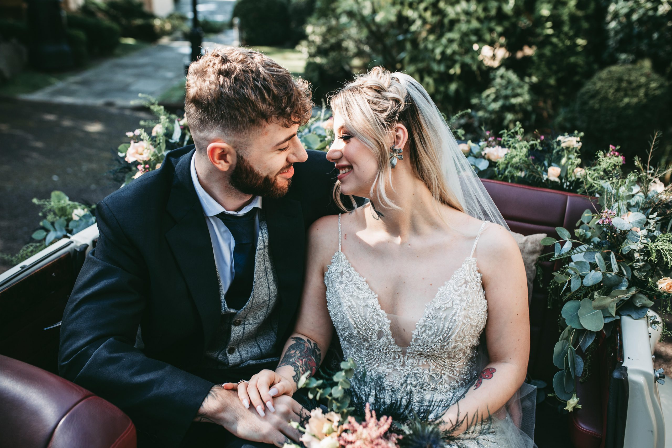 bride and groom sat inside kingfisher wedding car