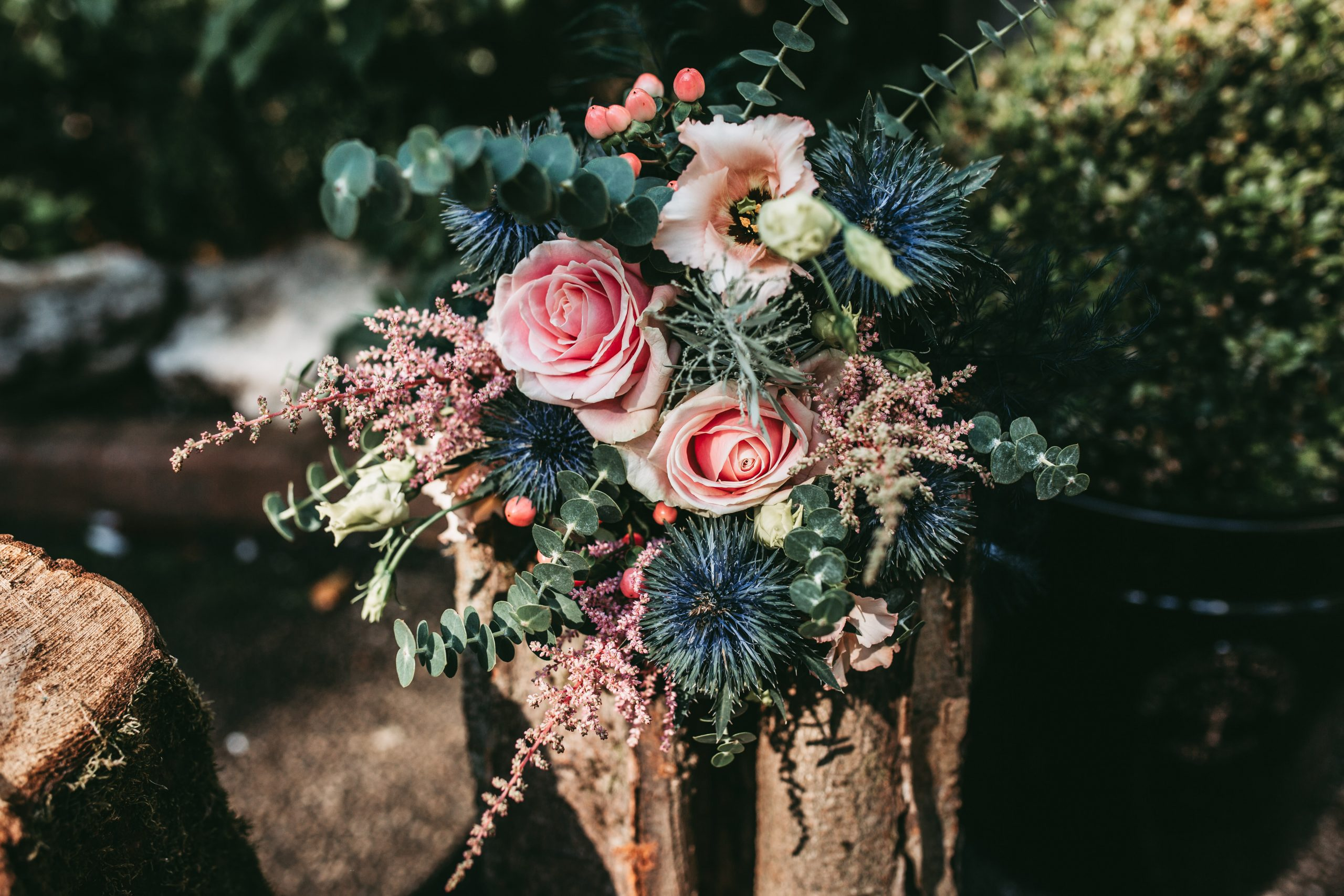 beautiful pink and blue bridal bouquet on log