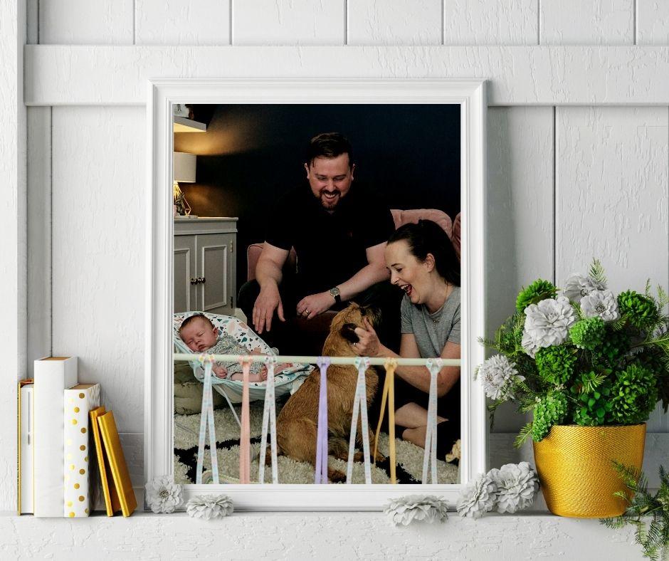 family print in white frame at home