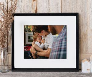 black block frame of breastfeeding mum on shelf