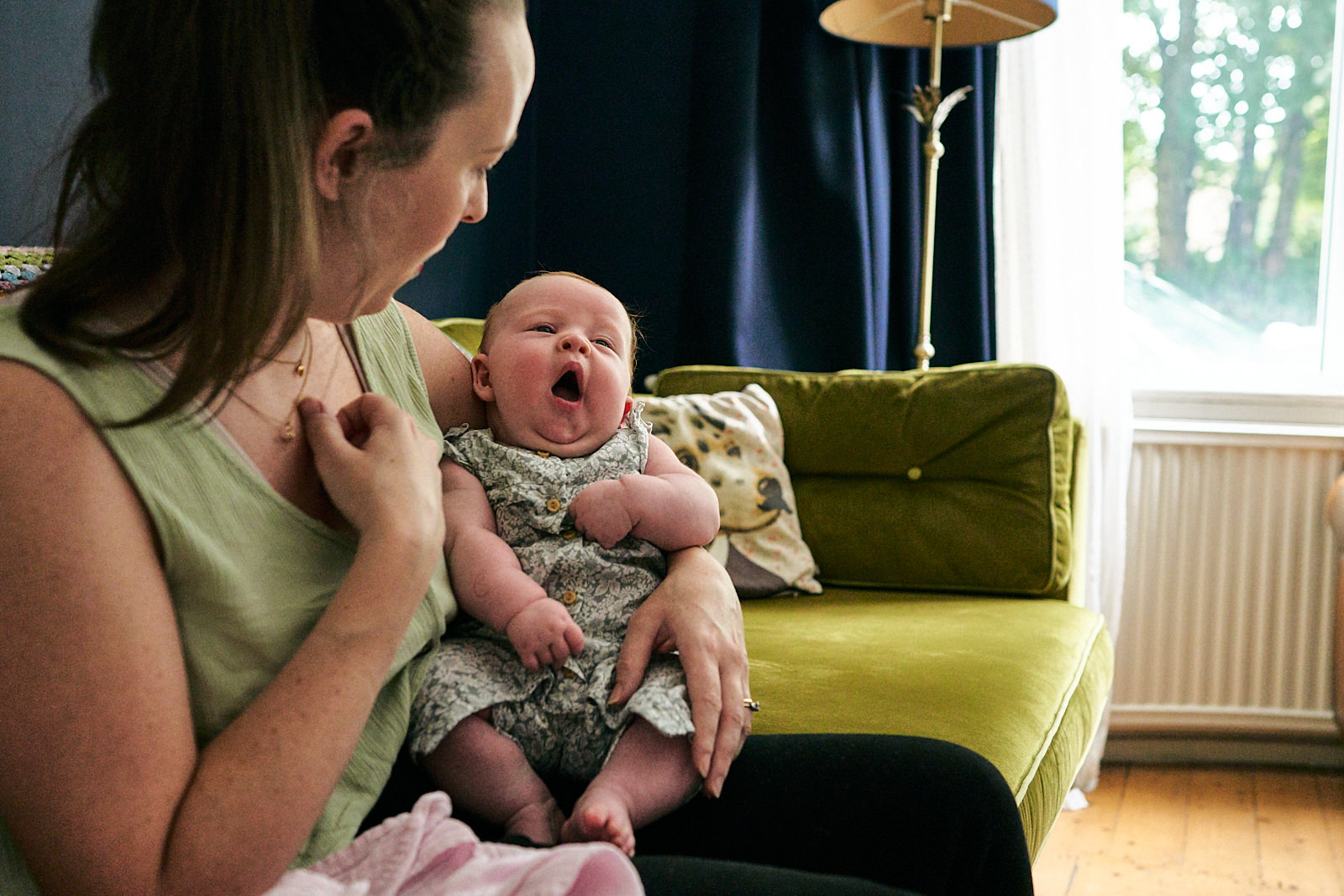 mum with newborn at home in wigan yawning