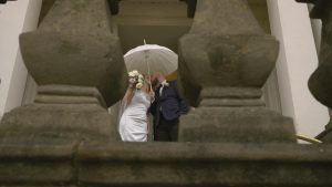 couple pose for video after micro wedding at Southport Town Hall