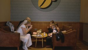 bride and groom drink hot chocolate in Costa southport