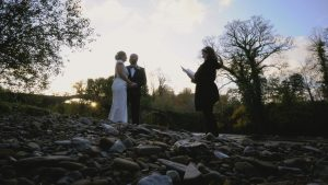 celebrant ceremony by river with sunkissed ceremonies