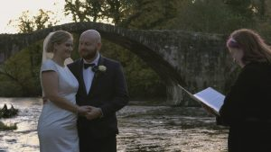 couple laugh during outdoor elopement ceremony