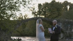 couple laugh as they say their vows during elopement