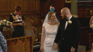 bride and groom smile during a small ceremony at Southport town hall