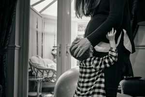 big brother kisses baby bump during photoshoot