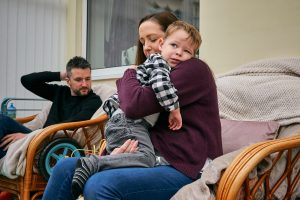 son cuddles in to mum and bump during photoshoot