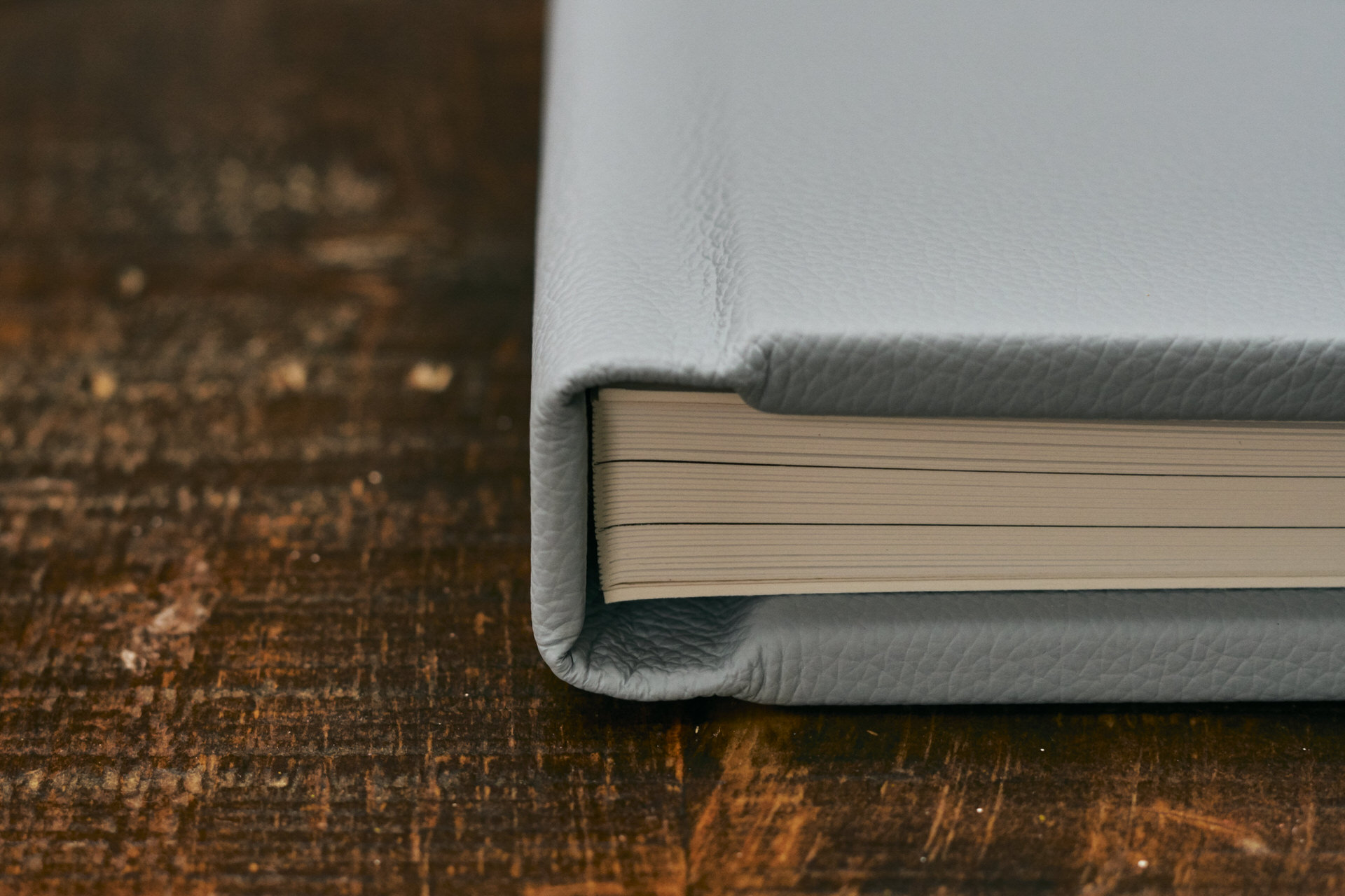 close up of fine art paper pages inside leather album