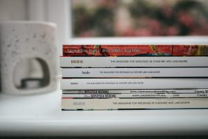 Wedding planning magazines pile including little white books