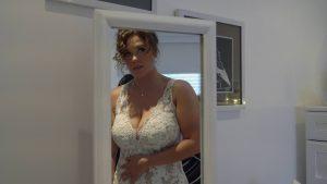 video still of bride getting ready in mirror at home in preston