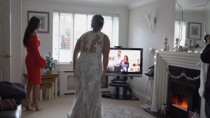 bride shows off dress to brother virtually on Facebook