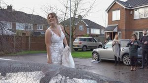 covid bride laughs distanced from neighbours in preston