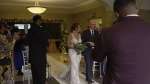 bride walks down aisle at Preston Marriott Lancashire