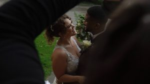 natural photo of couple being photographed on wedding day