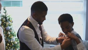 groom helps young nephew get ready