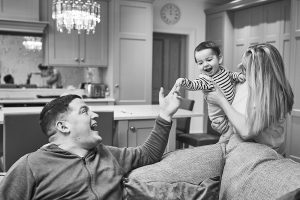 parents laughing with baby boy