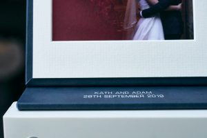 close up of couples names on wedding USB