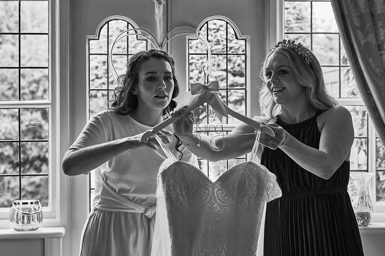 natural photo of bride with sister getting ready