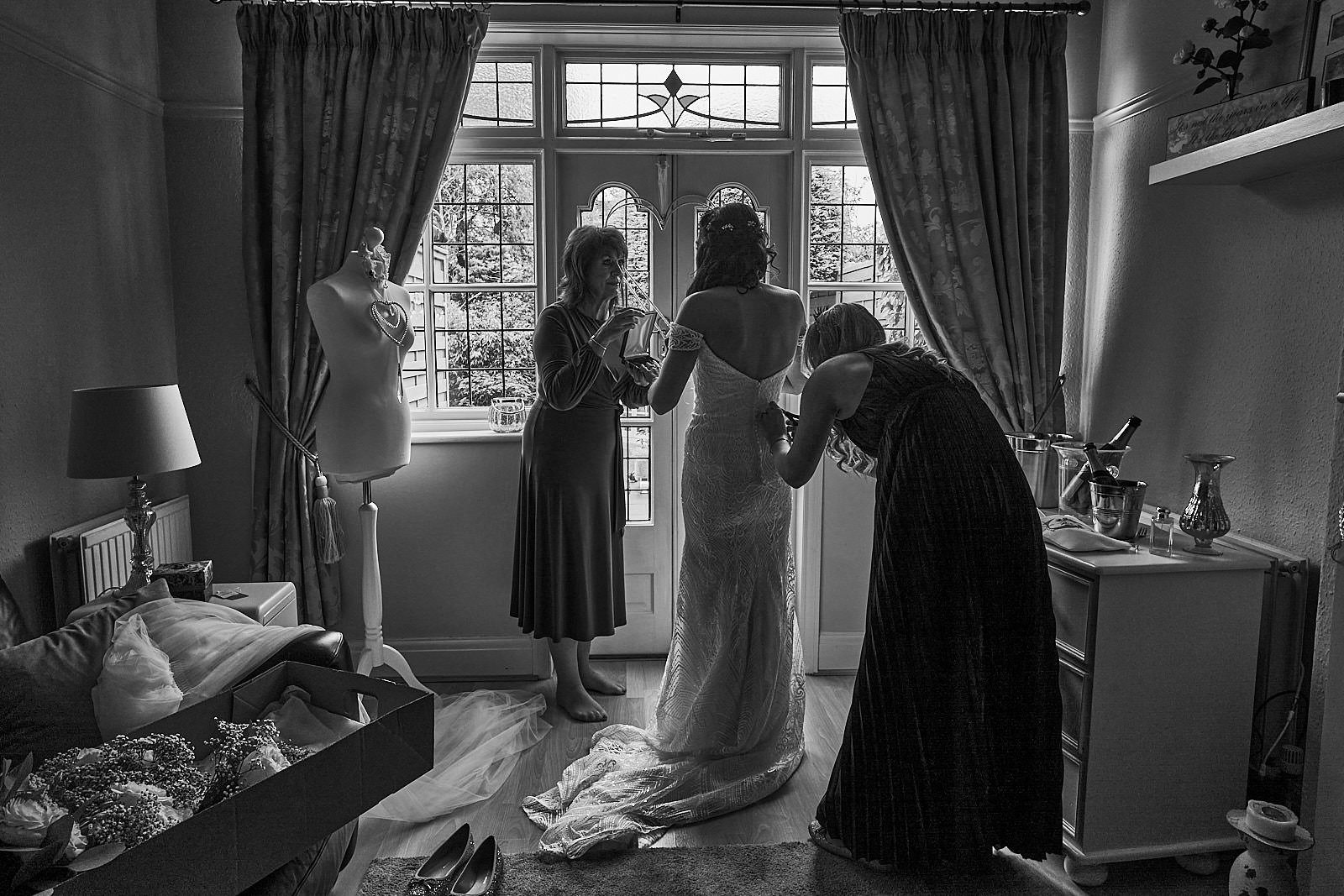 natural photo of bride getting help to get ready near Liverpool