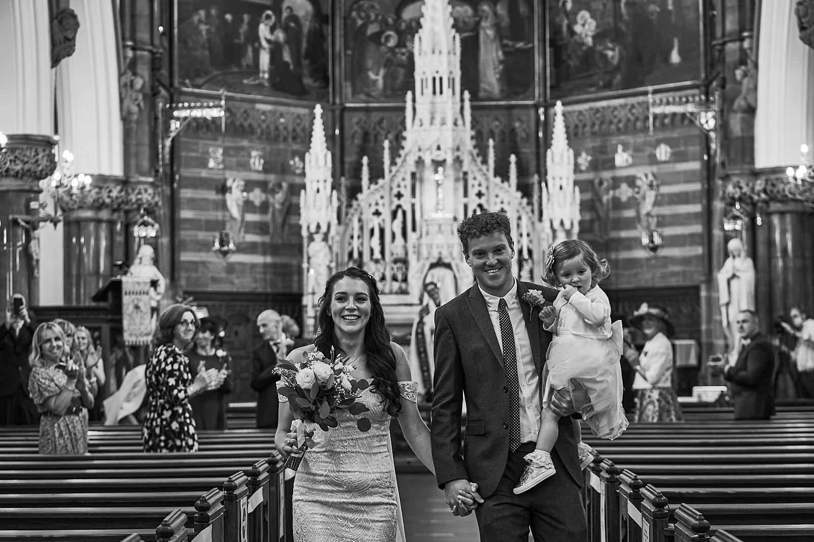 natural photo of happy couple married in church near Liverpool