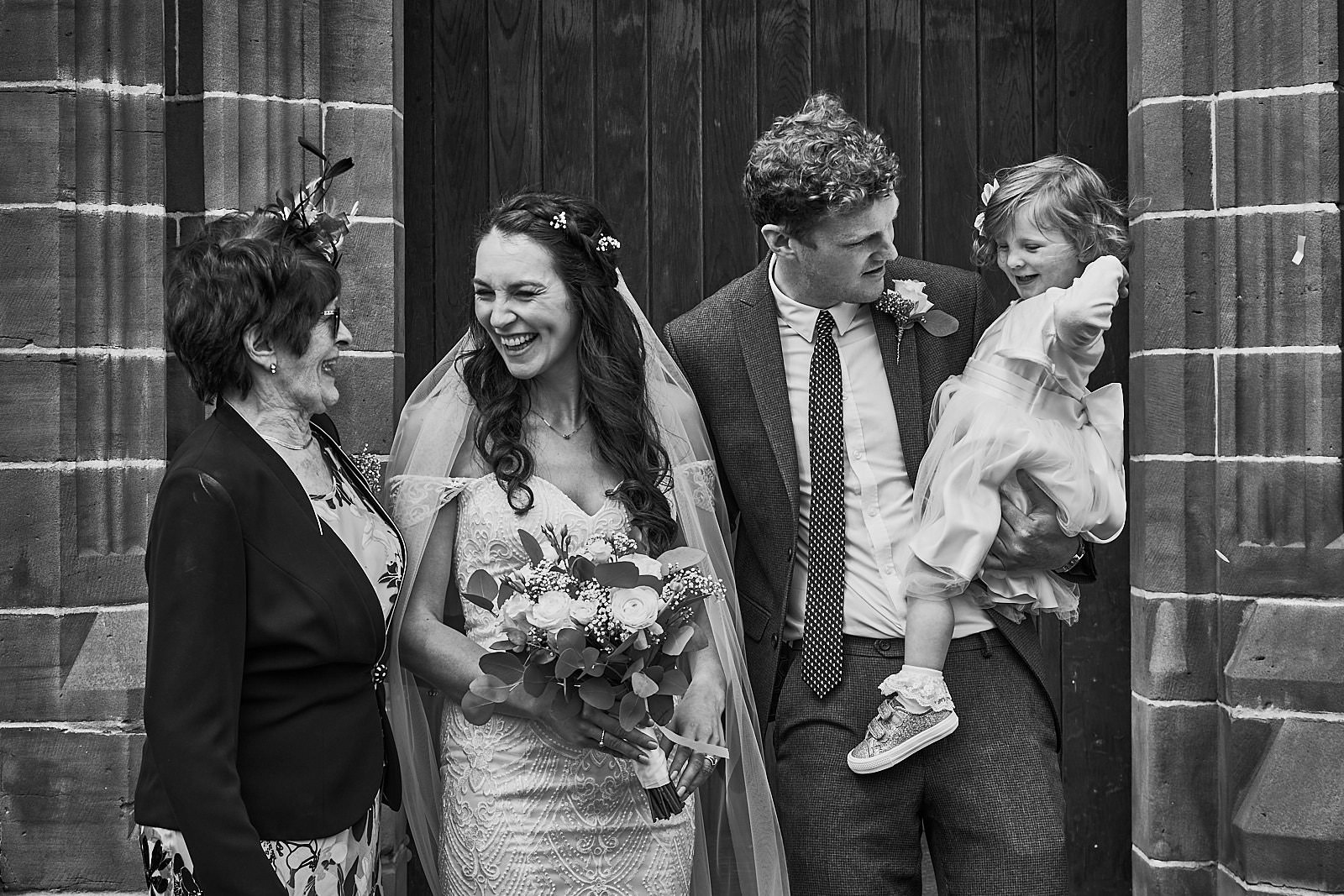 informal and relaxed wedding group shot outside church